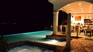2 outdoor pools, open 8 AM to 10 PM, pool loungers
