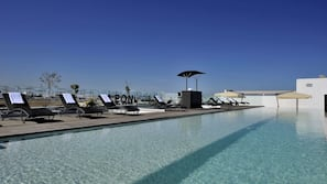 Seasonal outdoor pool, open 8:00 AM to 7:00 PM, pool umbrellas