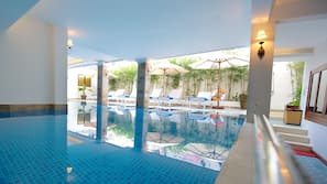 Indoor pool, open 7:00 AM to 10:00 PM, pool umbrellas, pool loungers