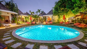 Outdoor pool, open 7:00 AM to 6:00 PM, pool loungers