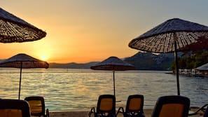 On the beach, sun loungers, beach umbrellas, beach volleyball