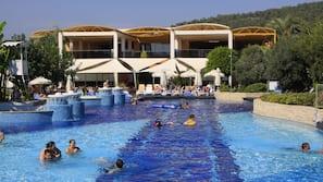 Indoor pool, 9 outdoor pools, open 8 AM to 7 PM, pool umbrellas