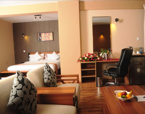 WE Hotel and Suites