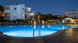 Outdoor pool, open 7:30 AM to 6:00 PM, pool umbrellas, pool loungers