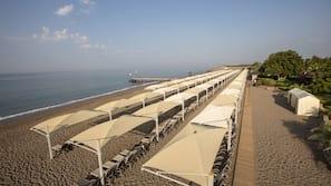On the beach, sun loungers, beach umbrellas, beach bar