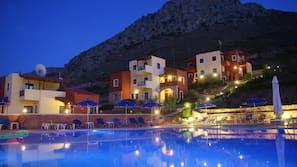 Outdoor pool, a rooftop pool, pool umbrellas, pool loungers