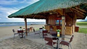 Private beach, black sand, free beach cabanas, beach massages