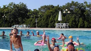 Seasonal outdoor pool, open 9:00 AM to 6:00 PM, lifeguards on site