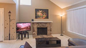 55-inch LCD TV with cable channels, fireplace