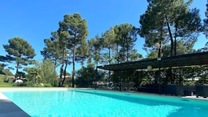 Seasonal outdoor pool, open 8:00 AM to 10:00 PM, sun loungers