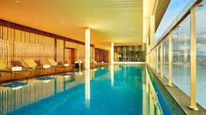 Indoor pool, open 6:00 AM to 9:00 PM, pool loungers