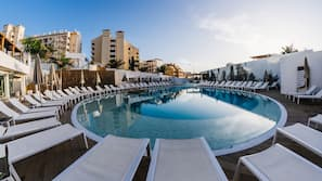 Outdoor pool, open 10 AM to 6 PM, pool umbrellas, pool loungers