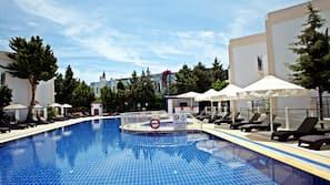 Seasonal outdoor pool, open 9:30 AM to 7:30 PM, pool umbrellas