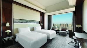 Premium bedding, down comforters, free minibar, in-room safe