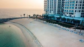 Private beach, white sand, beach umbrellas, beach towels