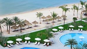 Private beach, white sand, beach umbrellas