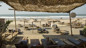 On the beach, beach umbrellas, beach towels, beach yoga