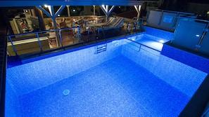 Seasonal outdoor pool, open 3:00 PM to 11:00 PM, pool umbrellas