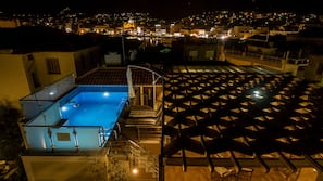 Seasonal outdoor pool, open 3:00 PM to 11:00 PM, pool umbrellas