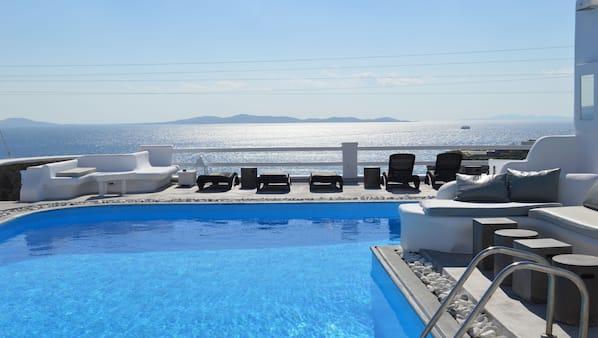 Seasonal outdoor pool, open 9:00 AM to 7:00 PM, sun loungers