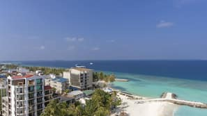 Private beach, white sand, sun loungers, scuba diving