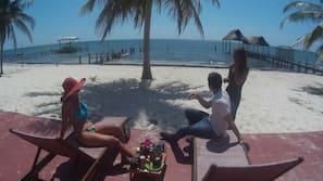 Playa privada, arena blanca, masajes en la playa y buceo con tubo