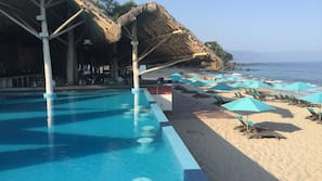 Outdoor pool, open 10:00 AM to 8:00 PM, cabanas (surcharge)