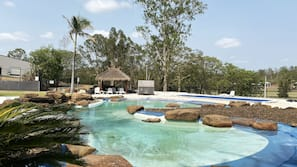 2 outdoor pools, open 8:00 AM to 9:30 PM, pool umbrellas, pool loungers