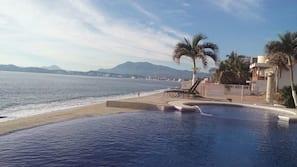 Outdoor pool, an infinity pool, sun loungers