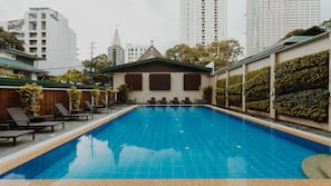 Outdoor pool, open 7:30 AM to 8 PM, pool loungers