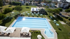 Outdoor pool, open 10:00 AM to 7 PM, pool umbrellas, pool loungers