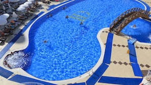 Outdoor pool, open 7 AM to 8 PM, pool umbrellas, pool loungers