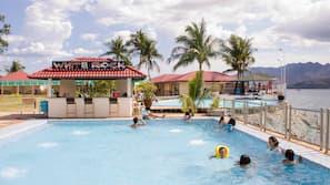 15 outdoor pools, pool umbrellas, pool loungers