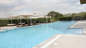 Outdoor pool, open 8:00 AM to 9:00 PM, sun loungers