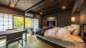 Premium bedding, down comforters, memory foam beds, free minibar