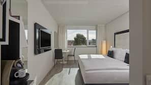 Luxe beddengoed, een kluis op de kamer, een bureau, gratis wifi