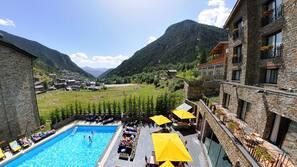 Seasonal outdoor pool, open 10:30 AM to 6:00 PM, pool umbrellas