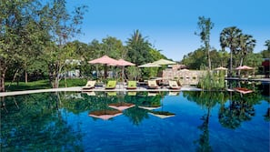 Outdoor pool, open 7:00 AM to 9:00 PM, pool umbrellas, pool loungers