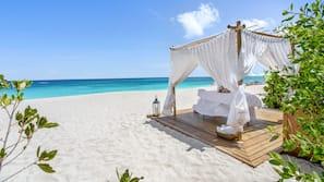 On the beach, white sand, windsurfing, beach bar
