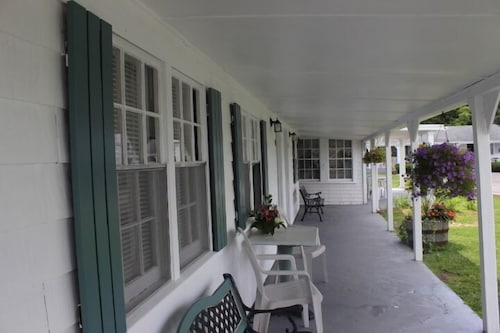 Porch, Shea's Riverside Inn & Motel