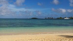 Beach nearby, white sand, beach cabanas, sun loungers