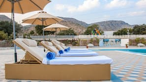 Outdoor pool, open 6:30 AM to 6:00 PM, pool umbrellas, pool loungers