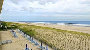On the beach, beach umbrellas, beach towels, surfing