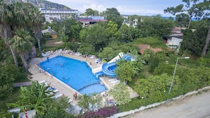 Seasonal outdoor pool, open 8 AM to 6:30 PM, pool umbrellas
