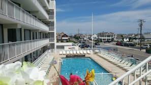 Seasonal outdoor pool, open 9:30 AM to 9:00 PM, sun loungers