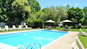 Seasonal outdoor pool, open 9 AM to 8 PM, pool umbrellas, pool loungers