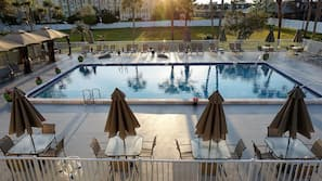 Outdoor pool, open 9 AM to 10 PM, free cabanas, pool umbrellas