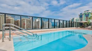 Outdoor pool, open 10:00 AM to 5:00 PM, pool umbrellas, pool loungers