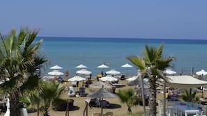 On the beach, beach towels, beach bar