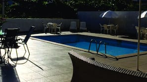 Outdoor pool, open 9 AM to 10 PM, sun loungers